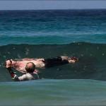 Bystanders help attacked Michael Cohen ashore. Photo: Mirror.